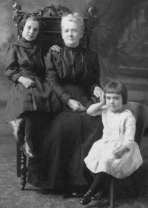Azilda Davignon Bonneau was my great-great-grandmother. In this studio portrait taken circa 1911, she is accompanied by two of her grandchildren. On the left is my grandmother Beatrice; on the right is her younger sister, Dinorah.