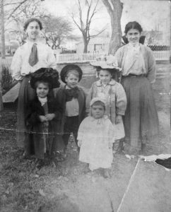 Back row: Elodia and Corinne Bonneau, sisters. Front row: Dinorah, Leonard, Beatrice, and Pauline Metthe. Photo presumably taken in the backyard near the shed, ca. 1909.
