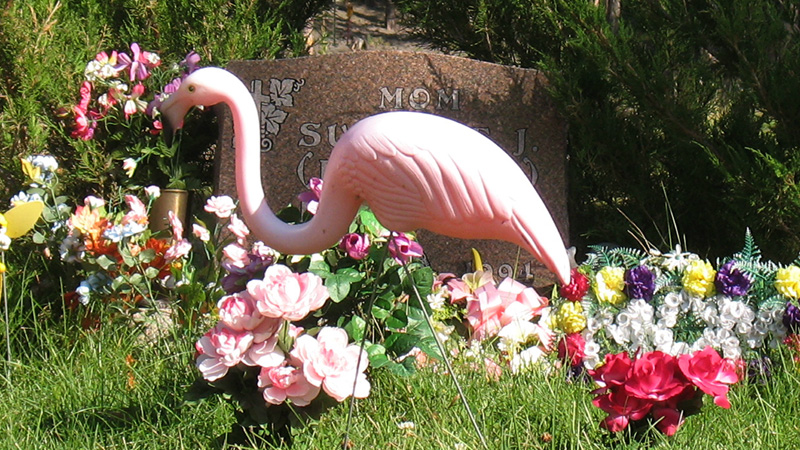Grave decorated with a flamingo. Keystone Cemetery, Keystone, South Dakota