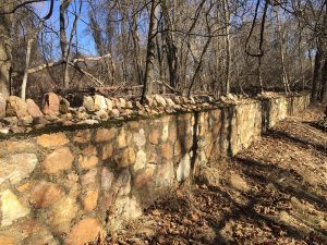 Stone retaining wall visible from New Hampshire Avenue. (J. Mangin, January 24, 2021)